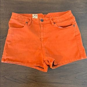 Bright coral Volcom denim high waisted shorts.